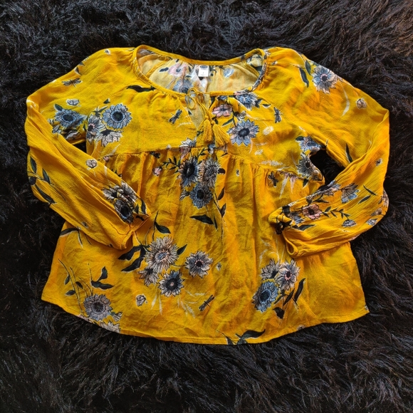 Long sleeved yellow floral flowy rayon blouse.